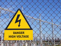 High Voltage. Warning signal in the fence of a power plant Royalty Free Stock Photo