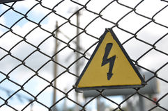 High voltage. Yellow sign of high voltage Royalty Free Stock Photo