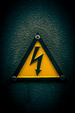 High voltage. Yellow grunge high voltage sign Stock Photography