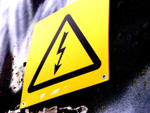 High Voltage. A bright yellow high voltage warning sign Stock Images