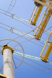 High voltage. Cable line before blue sky Royalty Free Stock Photo