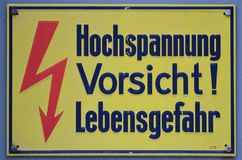 High voltage. Vintage german high voltage signboard Royalty Free Stock Photo