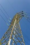 High voltage. Pylon over a blue clear sky Stock Photos