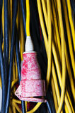 High voltage cable extension. Yellow high voltage cable extension with red plug Stock Photos