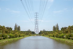 High voltage cable line on canel Stock Photo