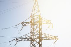 High voltage cable power post steel tower. Pylons in sunset scene twilight vintage color tone Stock Image