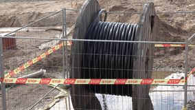 High voltage cable reel in wet dirt stock video