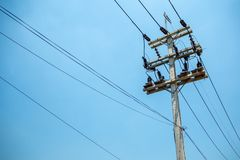 High voltage cables and equipments on pole with clear blue sky background stock images