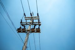 High voltage cables and equipments on pole with clear blue sky background royalty free stock images