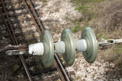 High-voltage ceramic insulator. On railway tracks background Royalty Free Stock Photography