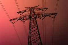 High voltage current mast at night Stock Images