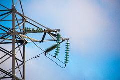 High voltage curved insulator with a snowcap Royalty Free Stock Photo