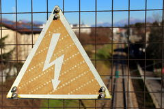 High voltage danger sign. On a metallic fence Royalty Free Stock Photos