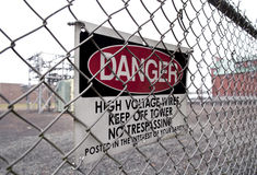 High Voltage Danger. Sign warning of high voltage at power plant Stock Photos