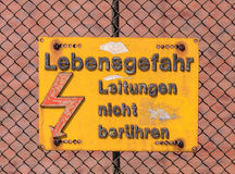 High voltage danger warning in German Royalty Free Stock Photo