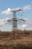 High-voltage electric main against the dark blue sky Stock Photo