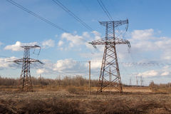 High-voltage electric main against the dark blue sky Royalty Free Stock Photography