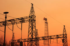 High voltage electric pillar. On sunset background Stock Image