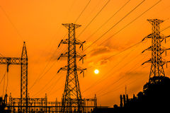 High voltage electric pillars on sunset background Stock Images