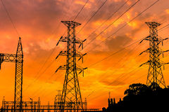 High voltage electric pillars on sunset background Royalty Free Stock Photography