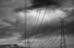 High voltage electric pole and transmission lines. Electricity pylons with dark sky and clouds. Power and energy. Energy. Conservation. High voltage grid tower royalty free stock photos