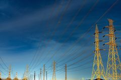 High voltage electric pole and transmission lines in the evening. Electricity pylons at night. Power and energy. Energy. Conservation. High voltage grid tower royalty free stock photography