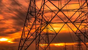High voltage electric pole and transmission lines in the evening. Electricity pylons at sunset. Power and energy. Energy. Conservation. High voltage grid tower stock photos