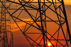 High voltage electric pole and transmission lines in the evening. Electricity pylons at sunset. Power and energy. Energy. Conservation. High voltage grid tower royalty free stock photos