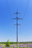 High-voltage electric pole with wires on a background of blue sk Royalty Free Stock Photos