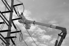 High voltage electric power line maintenance. In black and white stock images