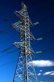 High voltage electric power lines. On blue sky with clouds Royalty Free Stock Images