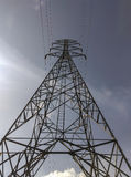 High voltage electric power lines on pylons. Royalty Free Stock Images
