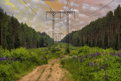 High voltage electric power lines. On sky with clouds Stock Photo