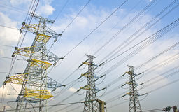 High Voltage Electric Power Plant. Electrical power line tower agaist blue sky Royalty Free Stock Image