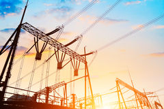 High Voltage electric substation in the sunset Stock Image