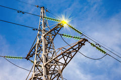 High voltage electric tower. Against blue sky Stock Photos