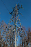 High Voltage Electric Tower. Against Blue Sky Stock Images