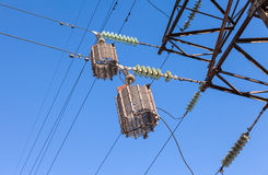 High voltage electric tower. Against the blue sky Stock Photo