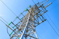 High voltage electric tower against the blue sky. Power transmission line Stock Images