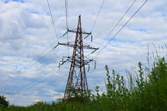 High Voltage Electric Tower. Against cloudy sky Stock Images