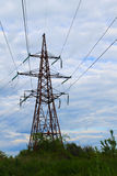High Voltage Electric Tower. Against cloudy sky Royalty Free Stock Photography