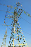 High Voltage Electric Tower. On blue sky Royalty Free Stock Photos
