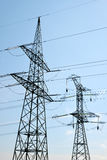High Voltage Electric Tower. On blue sky Royalty Free Stock Photo