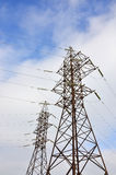 High Voltage Electric Tower. Electricity transmission pylon. High Voltage Electric Tower. Power lines concept. Outdoor day scene with clear blue sky Stock Photos