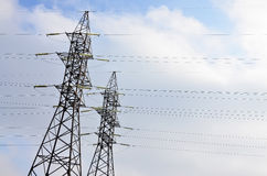 High Voltage Electric Tower. Electricity transmission pylon. High Voltage Electric Tower. Power lines concept. Outdoor day scene with clear blue sky Stock Image