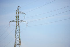 High Voltage Electric Tower. In the industrial zone Royalty Free Stock Photo