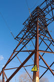 High Voltage Electric Tower. With sign against blue sky Royalty Free Stock Images