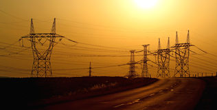 High voltage electric towers during sunset Stock Photography