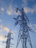High voltage electric towers on twilight sky Royalty Free Stock Photo