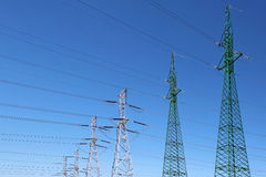 High voltage electric towers under blue sky. High voltage electric pylons under blue sky Royalty Free Stock Photo